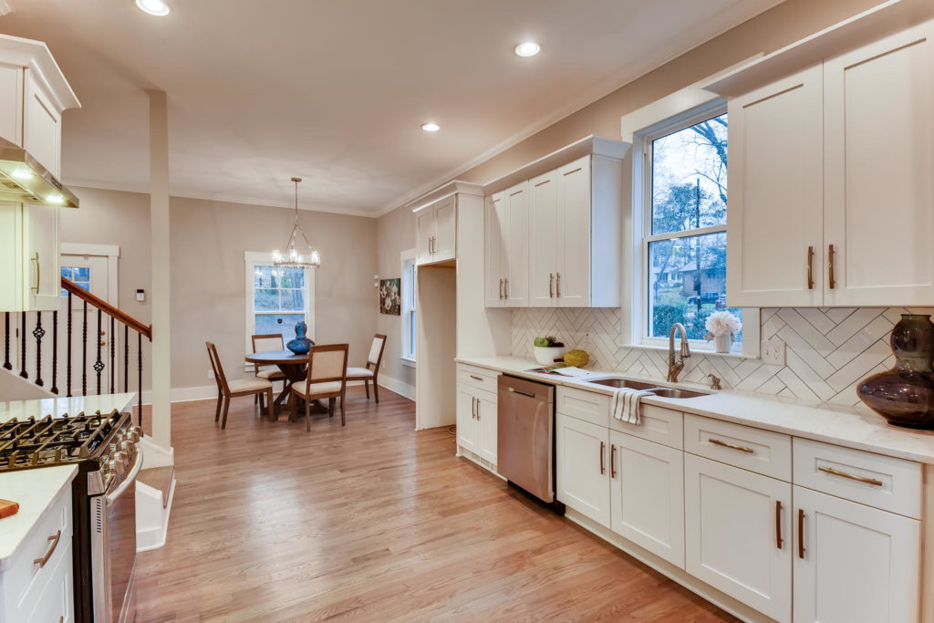Real estate picture of kitchen with window over sink