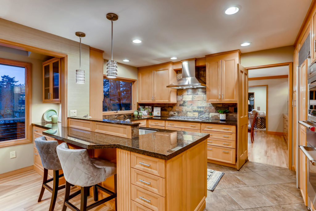 Real estate image of the kitchen with range and island