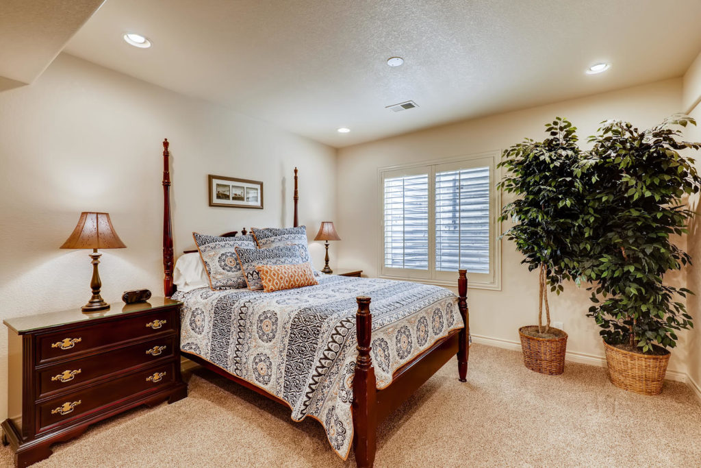Real estate picture of a guest room with plants