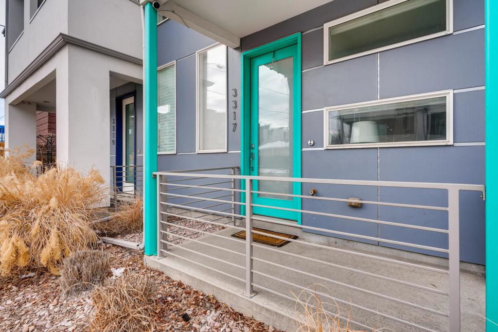 real estate image of teal door