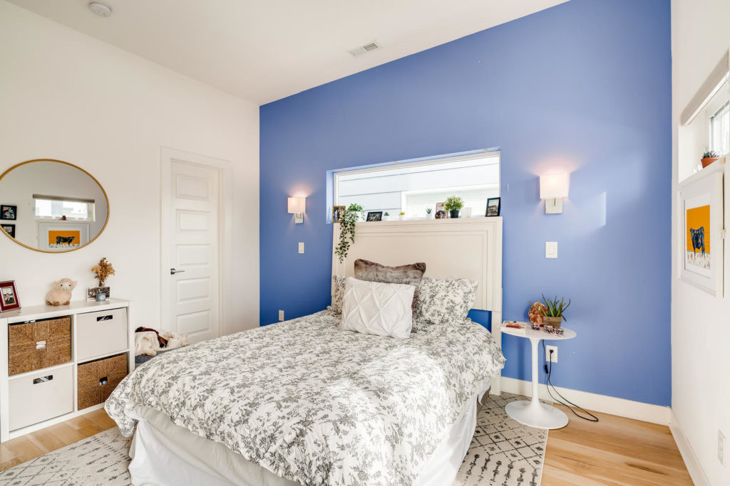 Real estate picture of bedroom with blue wall