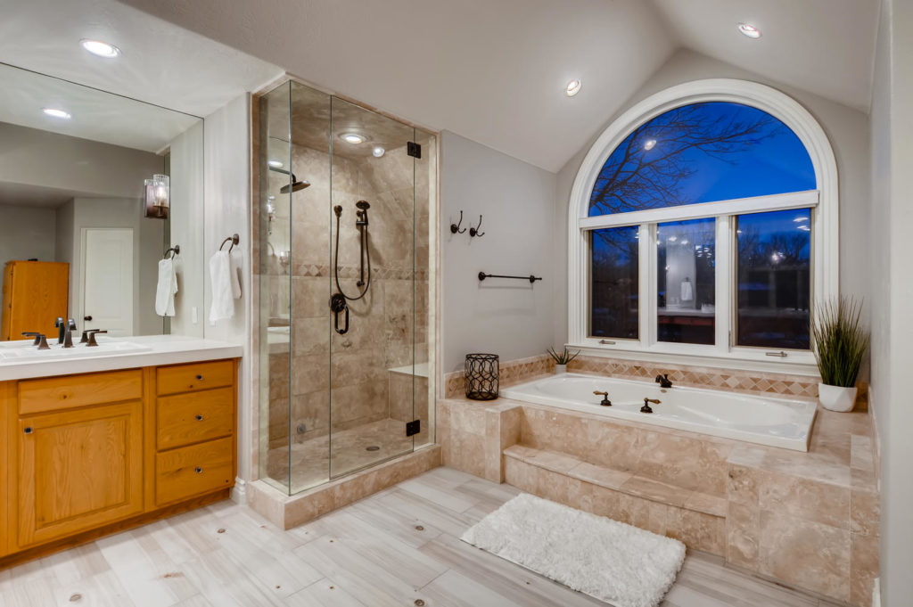 Luxury bathroom with large window and walk in shower