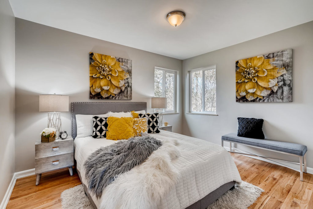 Bedroom with yellow pillow