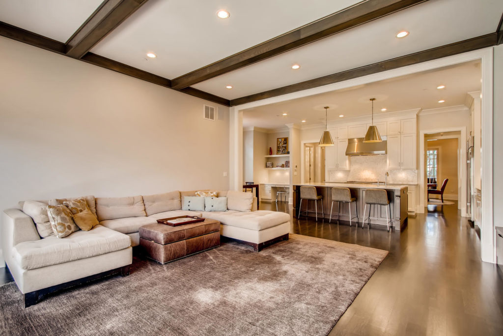 living room with sectional and kitchen