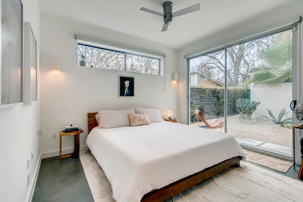 Beautiful bedroom with white duvet
