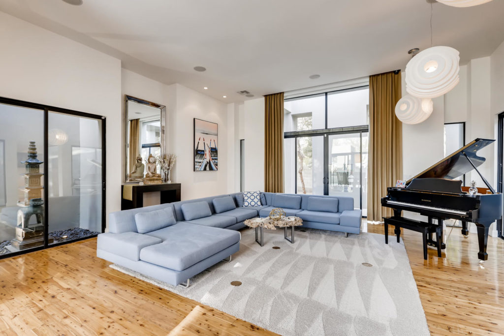 living room with large blue sectional