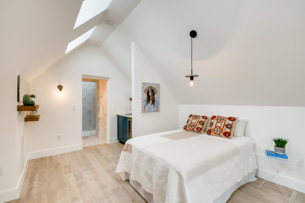 Bedroom with aframe ceiling