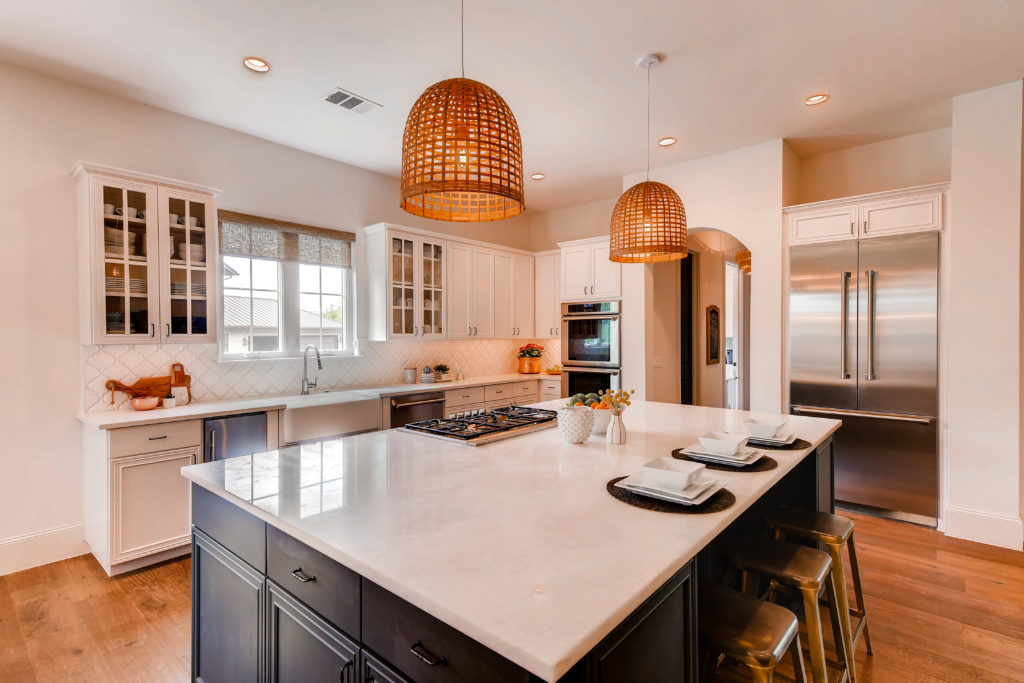Kitchen real estate image with wicker pendant lights