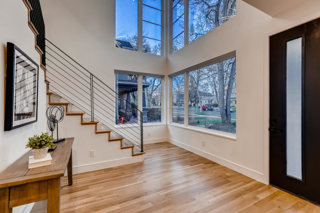 Foyer hallway with tall windows and stairs