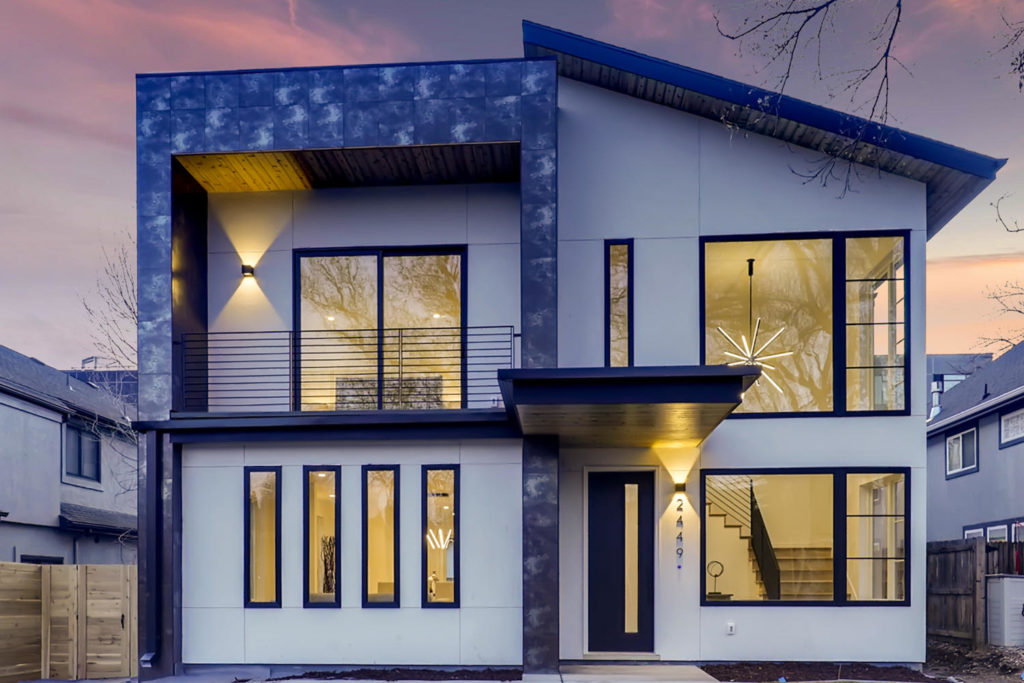 Exterior image of a modern home with white siding