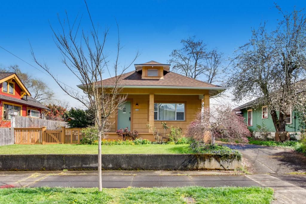 Bungalow home with teal door
