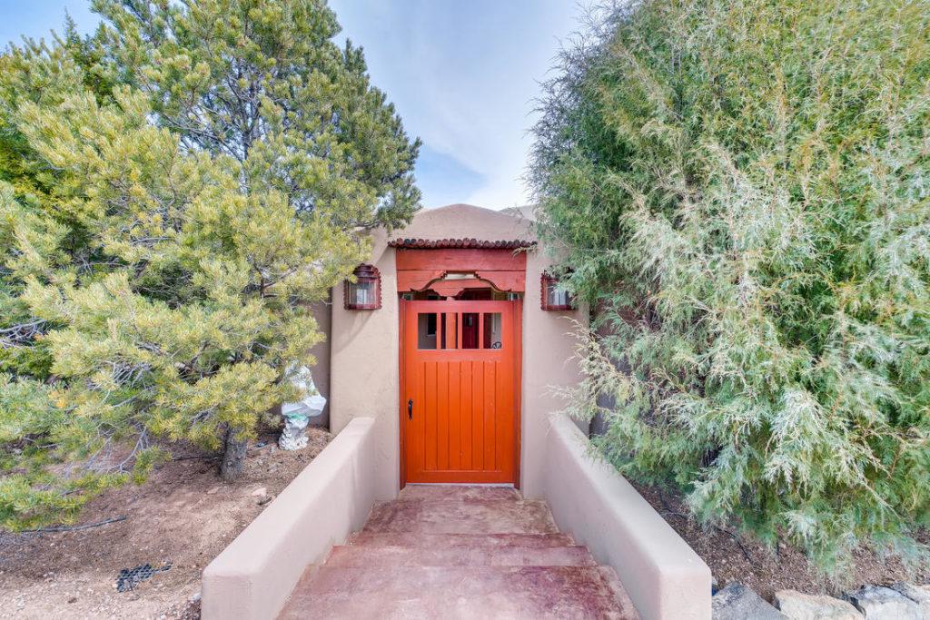 Red door on adobe home