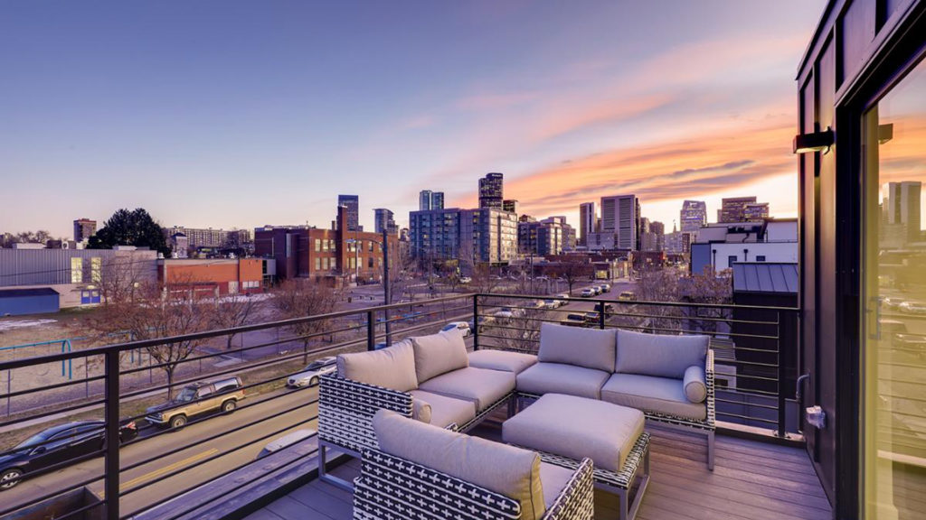 Balcony with view of city - real estate image