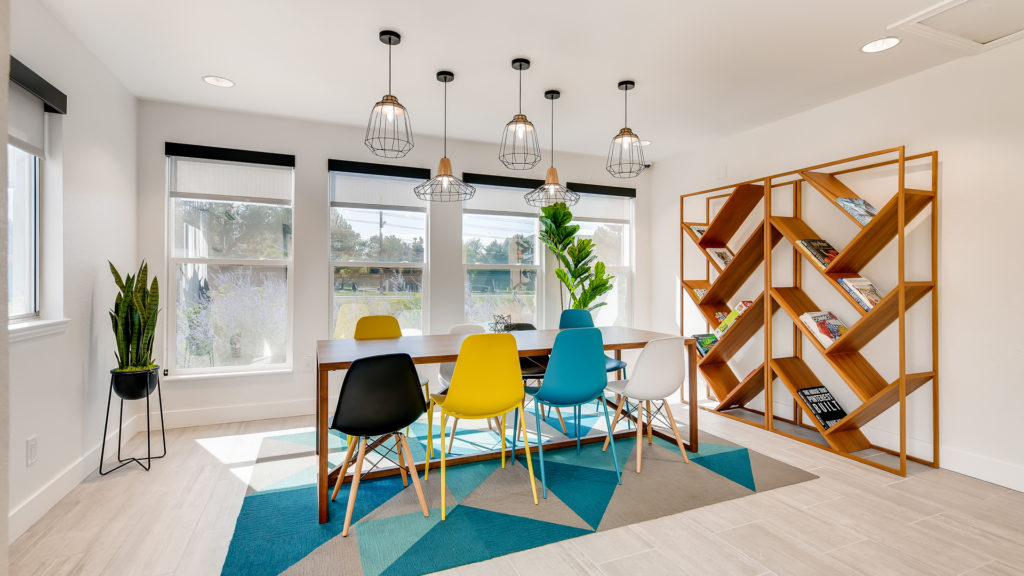 Dining room with yellow and blue chairs