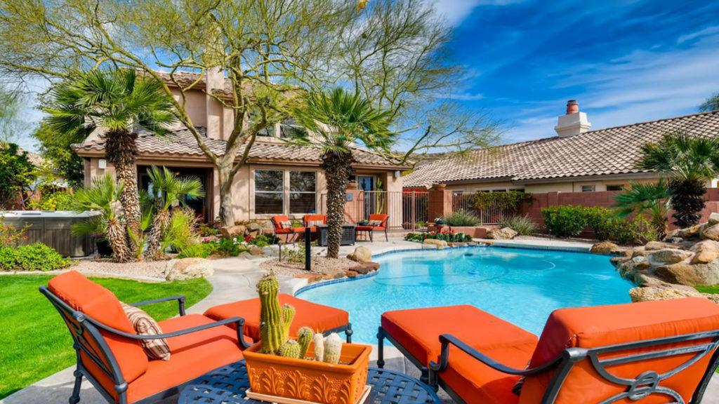 Pool with orange lounge chairs
