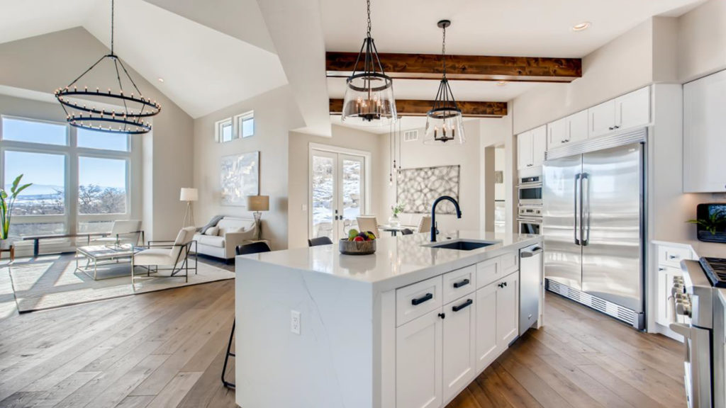Kitchen with white island and wood beams
