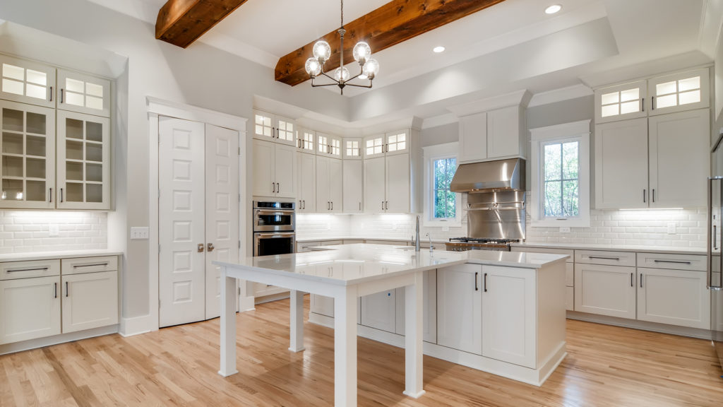 Large kitchen with island and wood beams