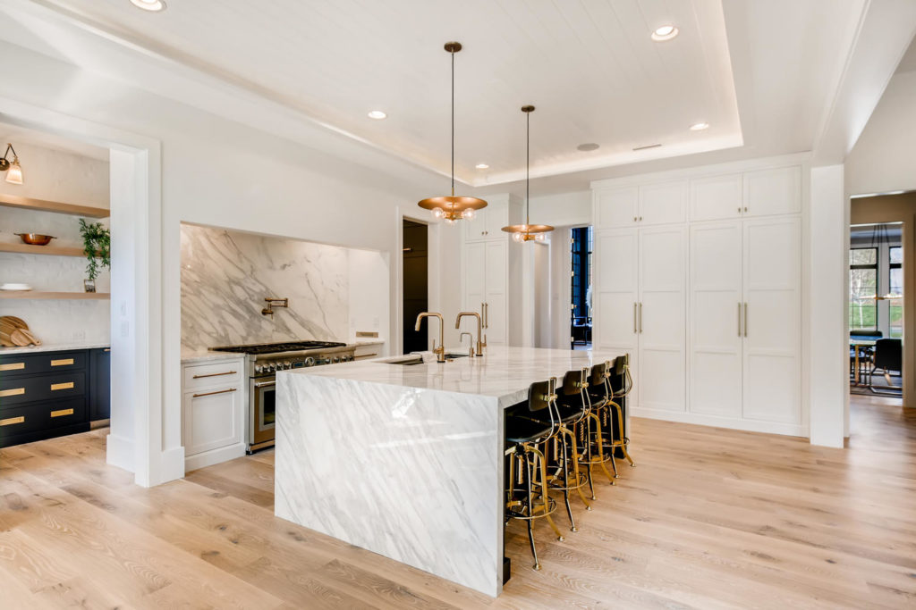 Kitchen with marble slab backsplash