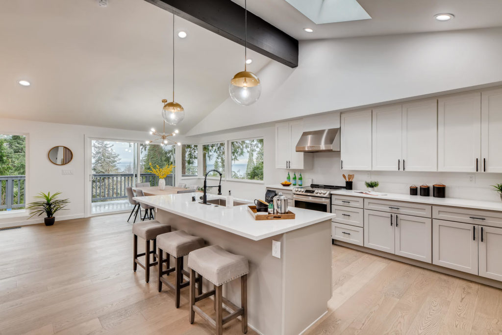 Kitchen with white cabinets and counters