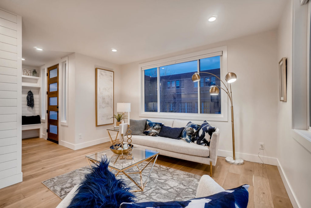 Front entry room and living room with white couch