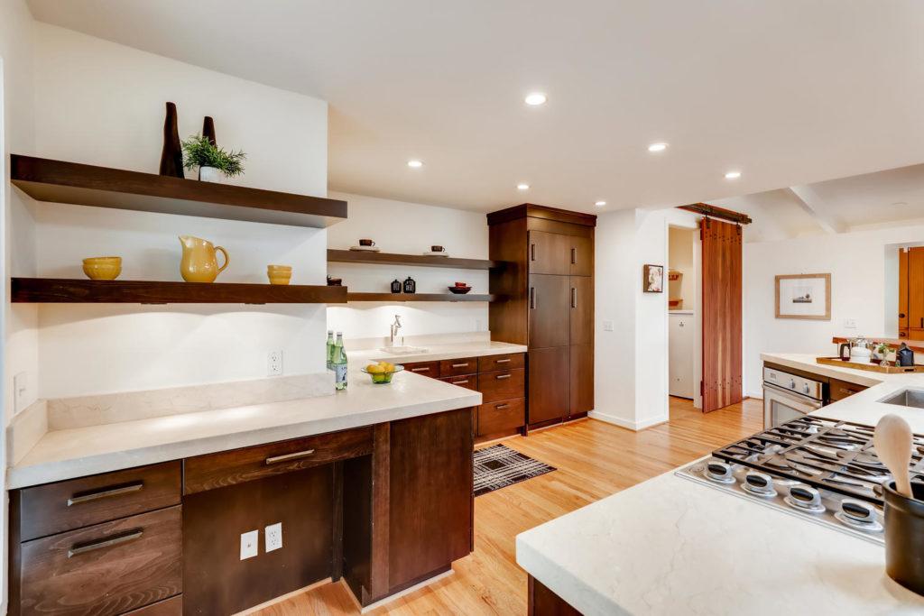 Kitchen with dark wood cabinets