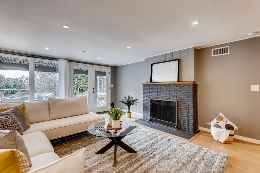 Family room with gray fireplace