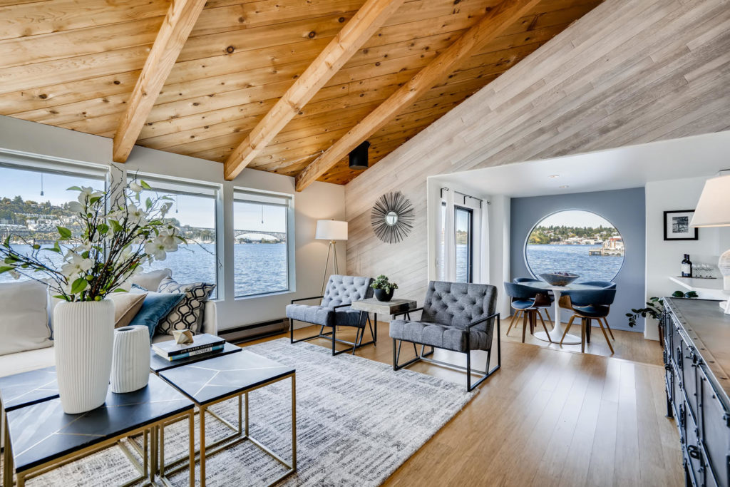 Living room with wood paneled ceilings