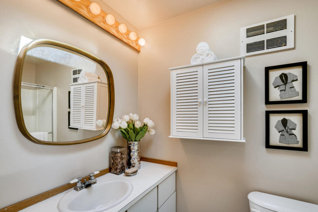 Bathroom with oval mirror