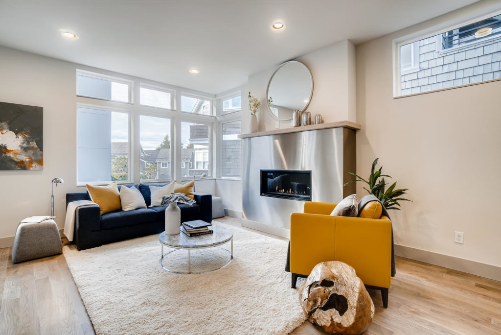 Living room with metallic fireplace