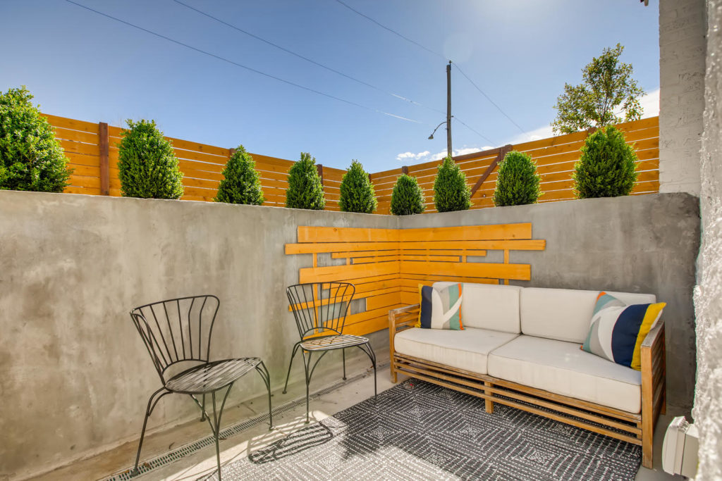 Backyard seating area with modern patio furniture