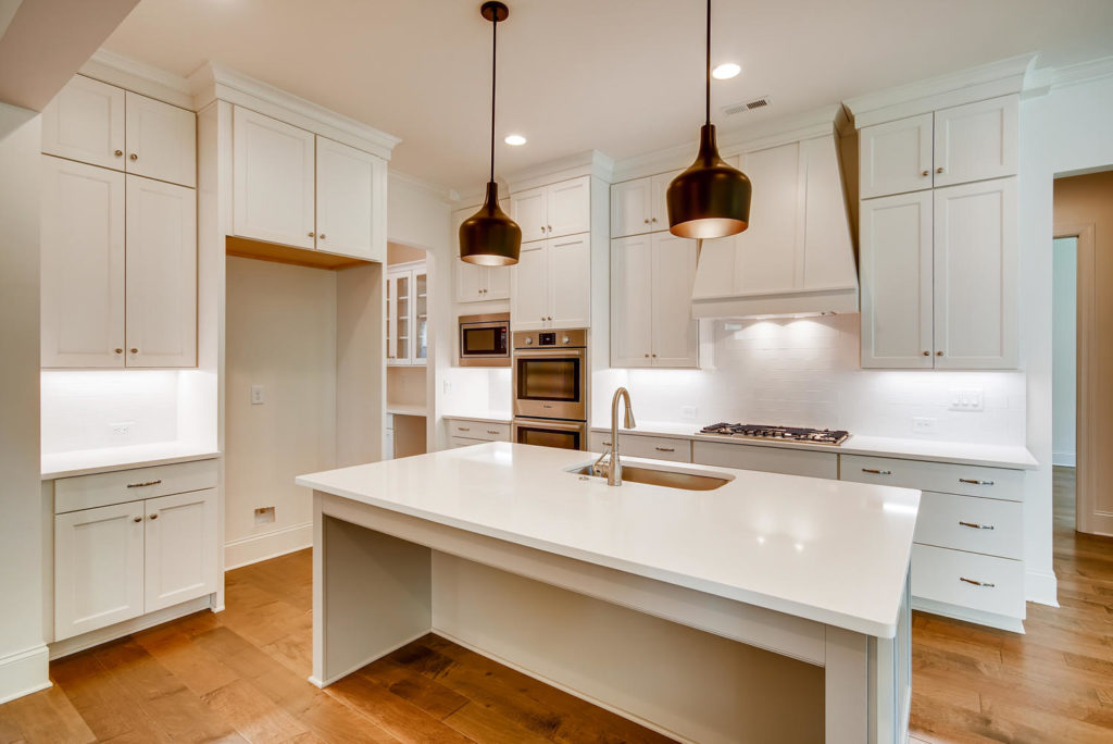 Kitchen with white waterfall island