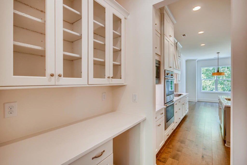Butlers pantry with glass cabinets