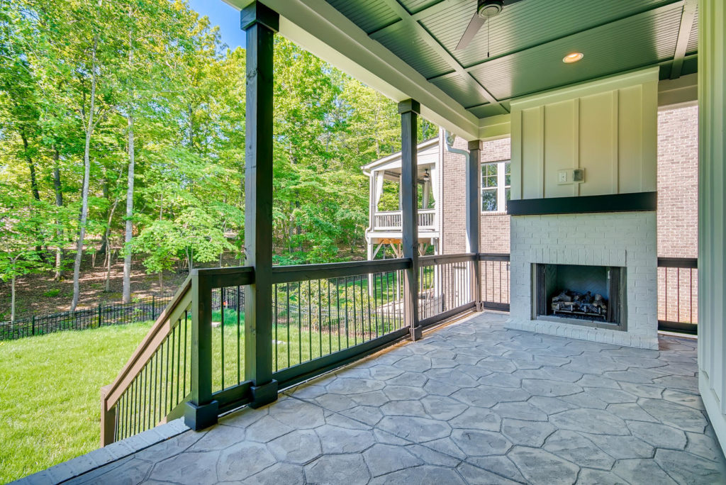 Back porch with outdoor fireplace