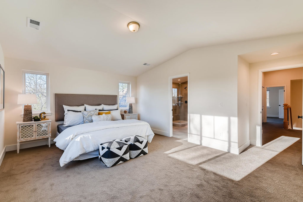 Large bedroom with white comforter