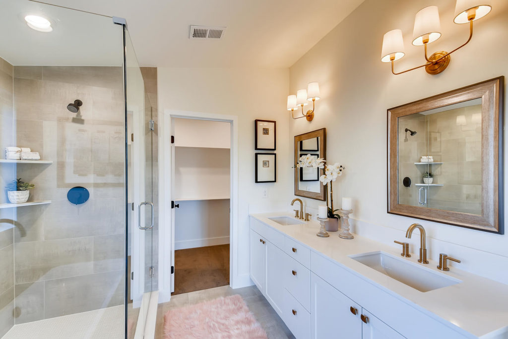 Bathroom with dual vanity and walk in shower