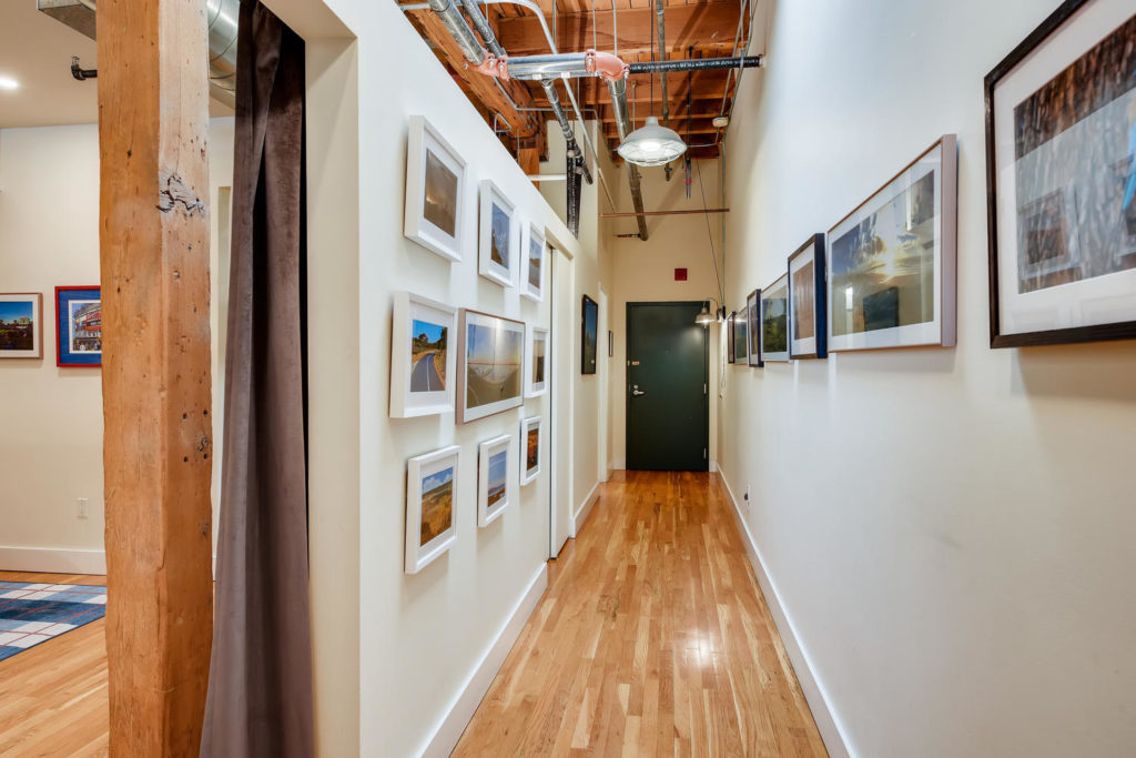 Hallway with gallery wall in loft