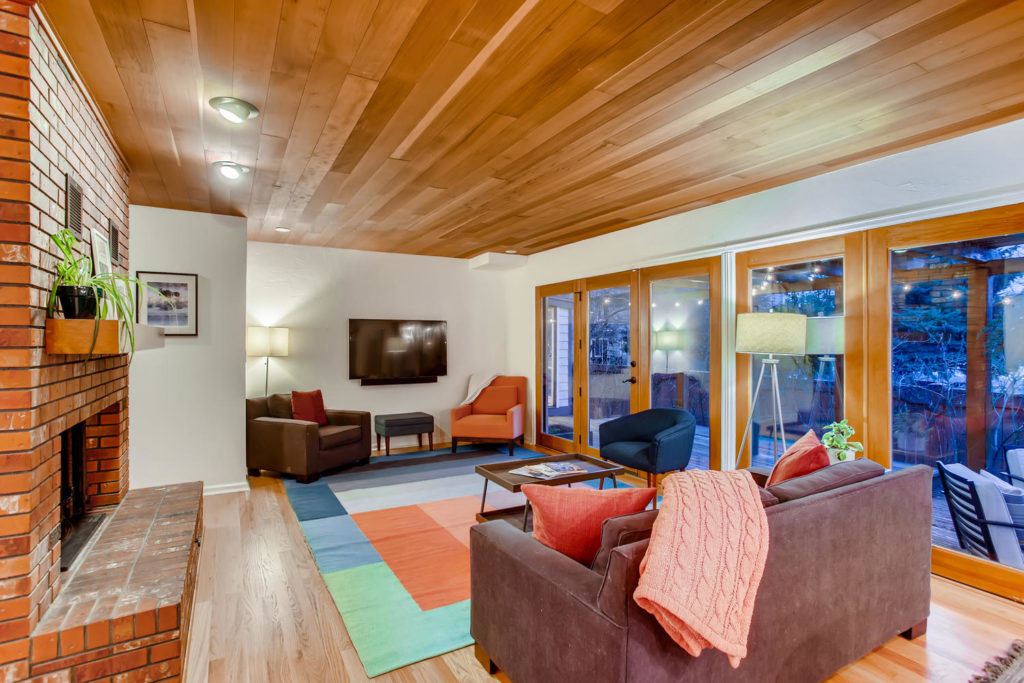 Colorful living room with wood panel ceilings