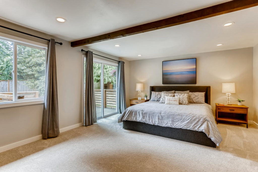 Large bedroom with wood beam