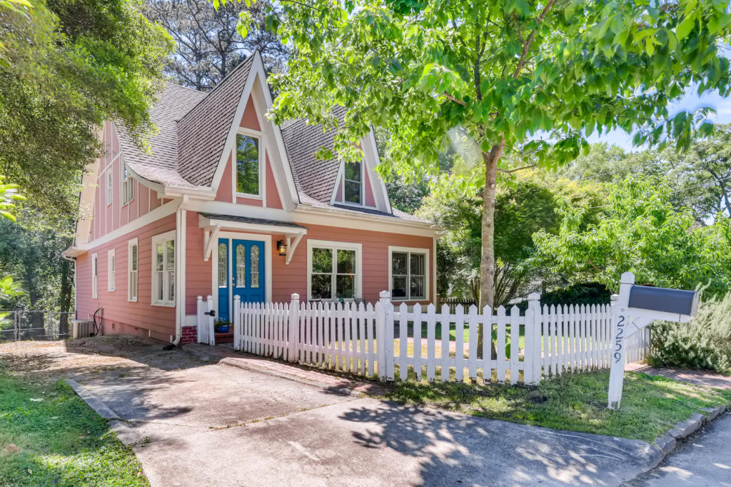 Atlanta home with pink siding and a blue door