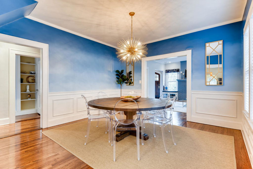 Atlanta dining room with pendant light and blue walls