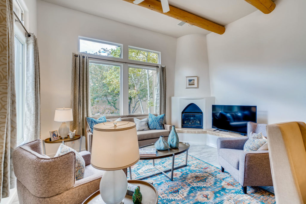 Santa Fe living room with fireplace adobe style home
