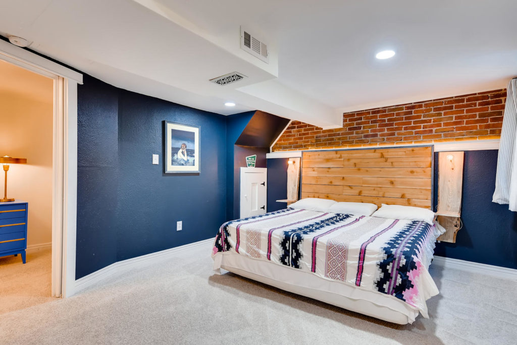 Large bedroom with navy walls