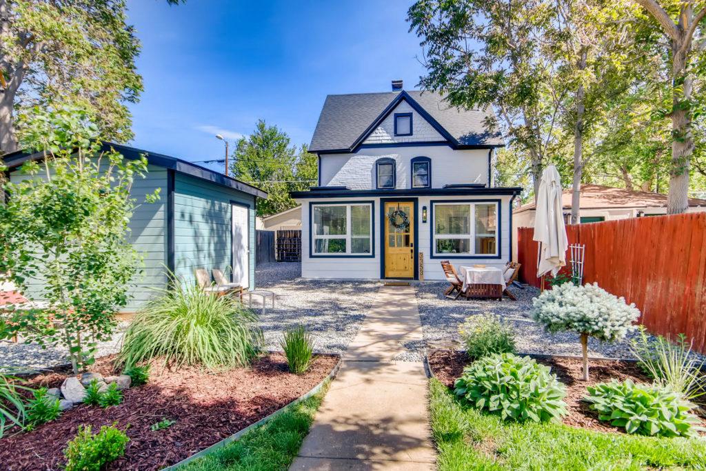 Denver bungalow with white siding and dark trim
