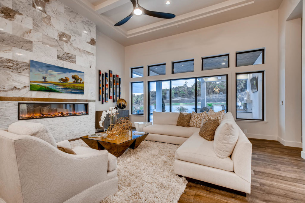 Large living room with white couches
