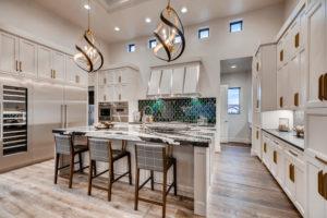 Gourmet kitchen with unique island lights