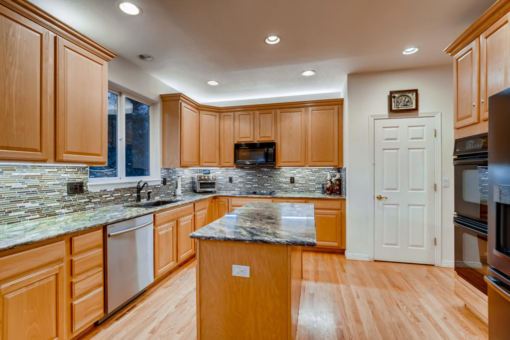 Kitchen with island and granite