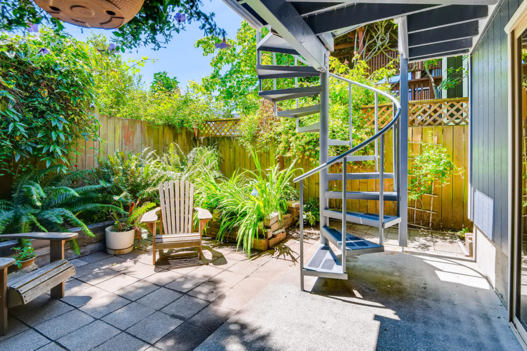 Back patio with spiral staircase