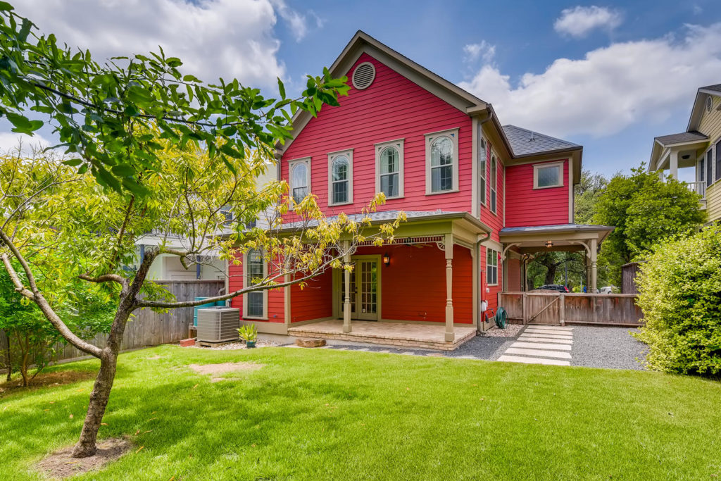 backyard red house - real estate image