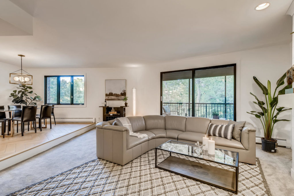 living room with large couch - real estate image