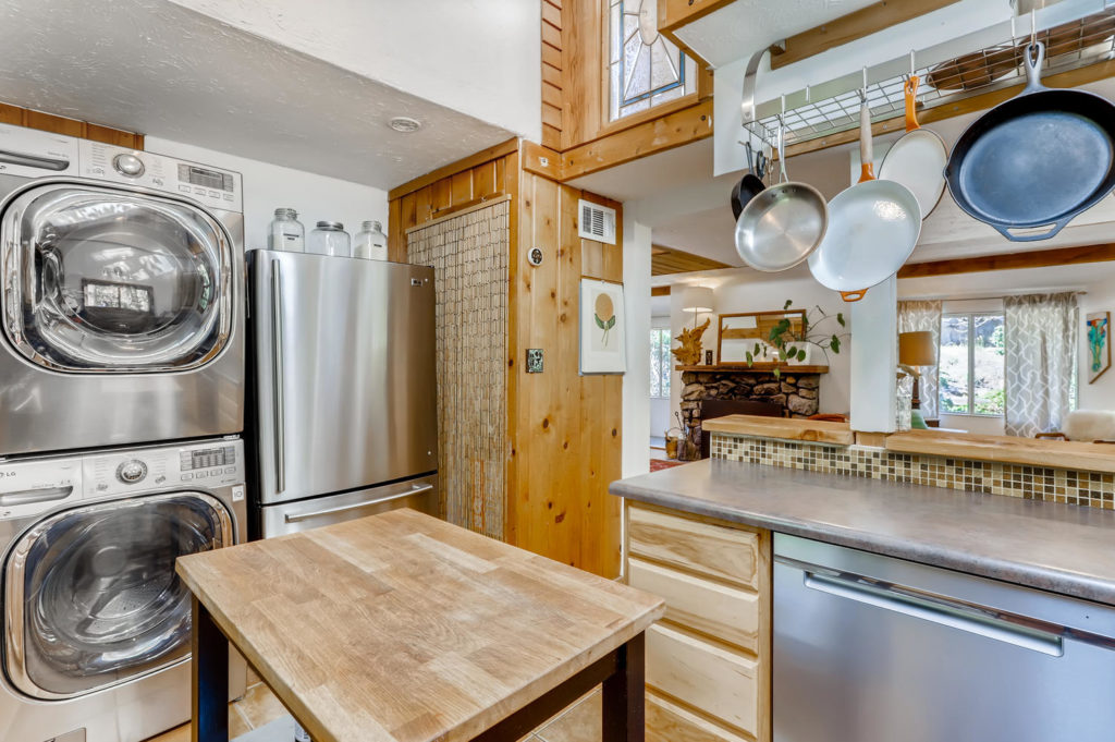 real estate photography - kitchen with stacked washer dryer
